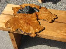 bench with burl as lily pad and frog on top