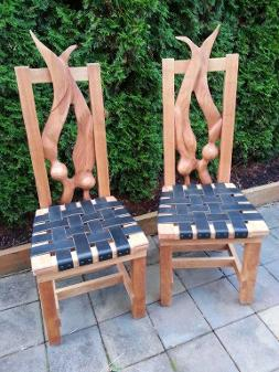 carved kelp chairs with leather seats