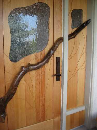 Exterior door with branch and glass, along with side panel