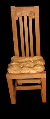carved wooden cushion on chair