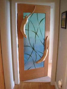 Carved Door with otters swiming in kelp glass
