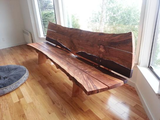 Carved bench with ocean splash